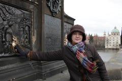 Woman touching sculpture Stock Photo