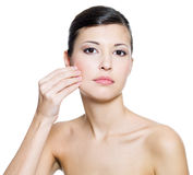 Woman touching  skin on cheek Royalty Free Stock Image
