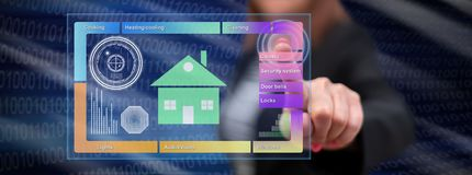 Woman touching a smart home concept. On a touch screen with her finger royalty free stock photo
