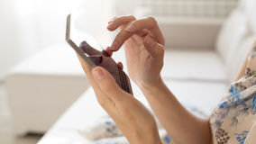 Woman touching smartphone. Woman touching cell phone in the room Royalty Free Stock Image