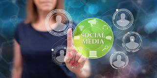 Woman touching a social media concept. On a touch screen with her finger royalty free stock photos