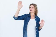 Woman touching something Stock Photography