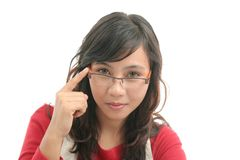 Woman touching spectacles. On white background Stock Photos