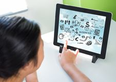 Woman touching tablet on stand showing black business doodles and sky Stock Photography