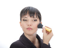 Woman touching up her make. Business woman touching up her make up stock photo