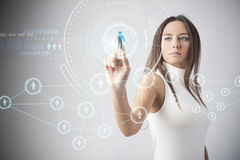 Woman touching the virtual future interface Stock Images