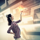 Woman touching virtual screen Royalty Free Stock Images