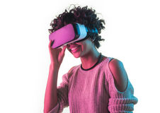 Woman touching VR headset. Isolated on white young woman touching her virtual reality goggles Royalty Free Stock Photos