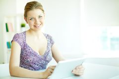 Woman with touchpad Stock Images