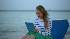 Woman with touchpad by the sea stock video footage