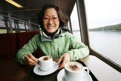 Woman on a tour boat, Lake District Stock Image