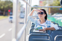 Woman touring city bus Stock Photography