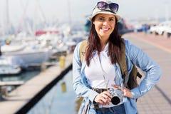 Woman touring harbour Royalty Free Stock Photos