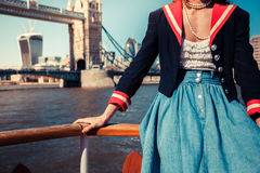 Woman touring the Thames on a boat Stock Image