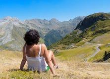 Woman tourist admiring views of the mountains. Royalty Free Stock Photo