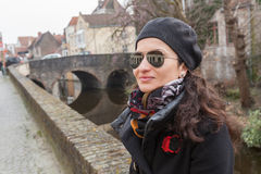 Woman tourist along canal in Bruges, Belgium Stock Image