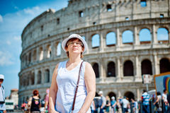 Woman tourist on the background of the Colosseum in Rome Stock Photo