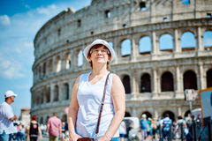 Woman tourist on the background of the Colosseum in Rome Royalty Free Stock Images