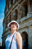 Woman tourist on the background of the Colosseum in Rome Royalty Free Stock Image
