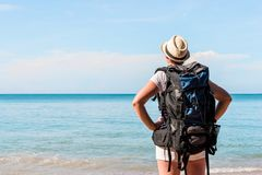 Woman tourist with a backpack admiring the beautiful scenery of Royalty Free Stock Photography