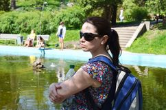 Woman tourist with a backpack and a bottle of water stock image