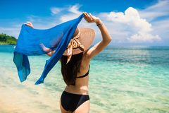 Woman tourist at tropical beach on vacation Royalty Free Stock Photo