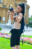 Woman tourist with camera Royalty Free Stock Photography