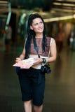 Woman tourist with camera Stock Photo