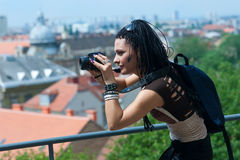 Woman tourist with camera Stock Image
