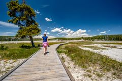 Tourist with camera hiking in Yellowstone Royalty Free Stock Images