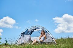 Woman tourist in the camping in the morning stock photography