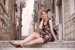 Woman tourist capturing memories.Young woman tourist,nomad,backpacker.Beautiful woman traveling alone.Korcula, Dubrovnik,Croatia t. Our.Outdoor summer smiling royalty free stock photo