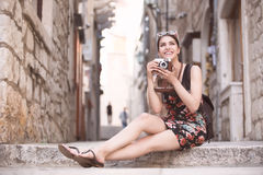 Woman tourist capturing memories.Young woman tourist,nomad,backpacker.Beautiful woman traveling alone.Korcula, Dubrovnik,Croatia t Royalty Free Stock Images
