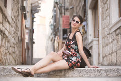 Woman tourist capturing memories.Young woman tourist,nomad,backpacker.Beautiful woman traveling alone.Korcula, Dubrovnik,Croatia t Stock Photography