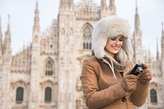 Woman tourist checking photos in digital camera near Duomo Royalty Free Stock Photos