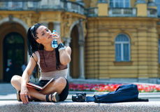 Woman tourist cooling herself Royalty Free Stock Image