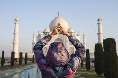 Woman tourist doing yoga mudra infront of Taj Mahal. India Royalty Free Stock Images