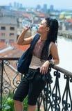 Woman tourist drinks water Stock Image