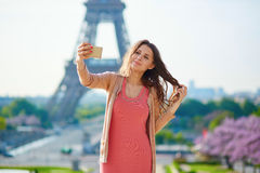 Woman tourist at Eiffel Tower making travel selfie Royalty Free Stock Photography