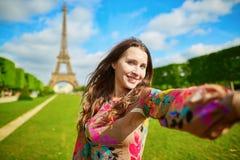 Woman tourist at Eiffel Tower making travel selfie. Woman tourist at Eiffel Tower smiling and making travel selfie. Beautiful European girl enjoying vacation in Stock Photo