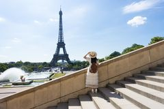 Woman tourist is enjoy siteseeing Eiffle Tower landmark of France, Paris during summer. Time royalty free stock photos