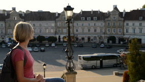 Woman tourist enjoying a view of a old city square stock video footage