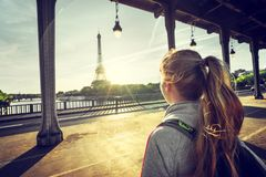 Woman tourist in front of the Eiffel Tower in Paris. Woman tourist walking  in front of the Eiffel Tower in Paris, France Royalty Free Stock Images