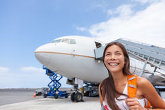 Woman tourist getting out of airplane at airport. Asian girl passenger walking out of stairs after plane landing arrival at airport at summer destination stock images