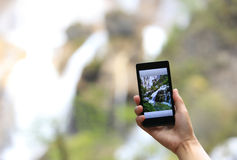 Woman tourist hand taking photo with smart phone Stock Photo