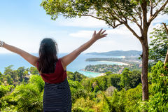 Woman tourist happy gestures on high scenic view Royalty Free Stock Photography
