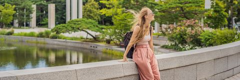 Free Woman Tourist In Korea. Korean Palace Grounds In Seoul, South Korea. Travel To Korea Concept BANNER, LONG FORMAT Royalty Free Stock Image - 168258246