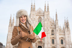Woman tourist with Italian flag showing thumbs up, Milan Stock Photos