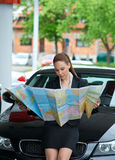 Woman tourist looking at map Stock Images