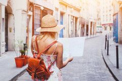 Woman tourist looking at the map on the street. Of european city, travel to Europe stock photos
